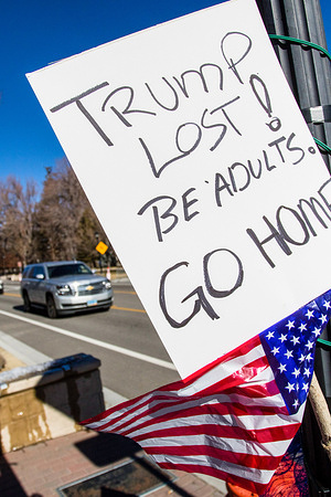 A protest sign left behind written on it 'Trump lost, be adults, go home'. Despite the promise of civil unrest, one protestor from each side attended the state capital for few minutes and not at the same time.