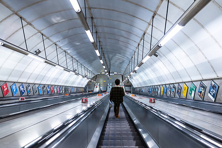 A man seen alone on the subway escalator in London.