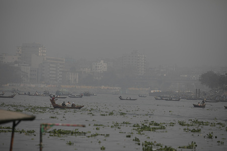 An overview of  Buriganga river covered with a fog. Temperatures have started falling across Bangladesh, especially in the northern and central parts where the skies are covered with dark clouds and fog.