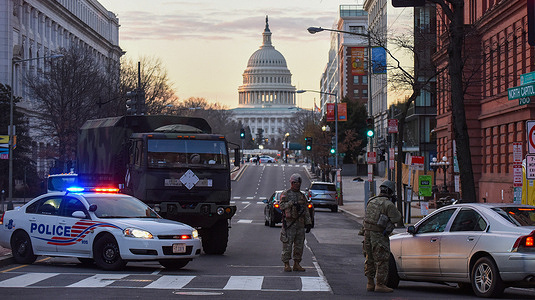 Police and National Guard soldiers stop vehicles at a checkpoint near the U.S. Capitol Building on the day before the inauguration ceremonies for President-elect Joe Biden. As many as 25,000 armed National Guard troops are expected in DC due to threats of violent protests.