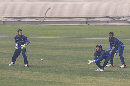 Bangladesh's Mushfiqur Rahim (R), Soumya Sarkar (C) and Mohammad Mithun (L) in action during a training session at the Sher-e-Bangla National Cricket Stadium in Dhaka.