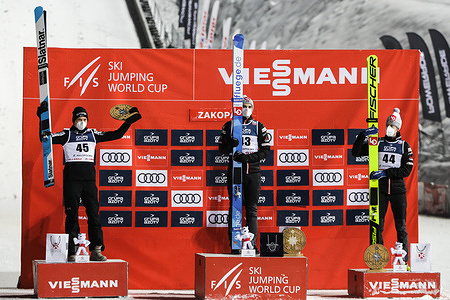 Anze Lanisek, Marius Lindvik and Robert Johansson seen on the podium after the individual competition of the FIS Ski Jumping World Cup in Zakopane.