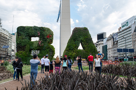 Tourists take selfies at the Obelisco.Known for its eclectic European architecture and a rich cultural life, Buenos Aires, with a population of about 3 million people (16 if you consider the Greater Buenos Aires) is thriving and full of life, a city with a rhythm of its own.