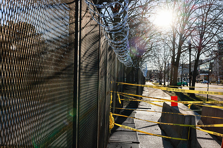 Razor wire and police tape closes access near the United States Capitol Building on the eve of the inauguration of president elect Joe Bien.