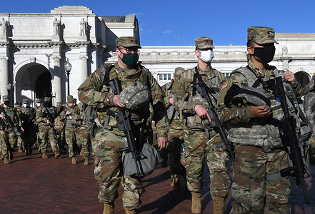 National Guard soldiers march from Union Station to the grounds of the U.S Capitol Building the day before the inauguration ceremonies for President-elect Joe Biden.  As many as 25,000 armed National Guard troops are expected in DC due to threats of violent protests.