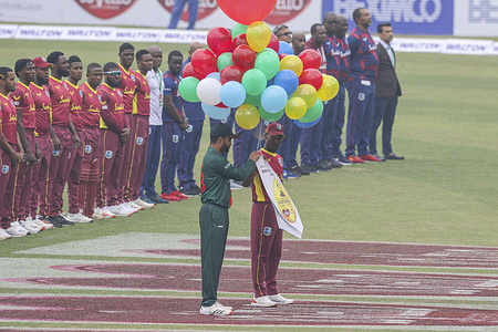 Bangladesh's captain Tamim Iqbal (L) and West Indies' captain Jason Mohammed release balloons before the start of the first one-day international (ODI) cricket match at the Sher-e-Bangla National Cricket Stadium in Dhaka.