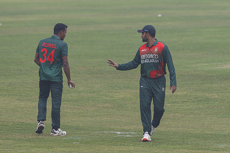Bangladesh's captain Tamim Iqbal (R) and Rubel Hossain (L) during the first one-day international (ODI) cricket match at the Sher-e-Bangla National Cricket Stadium in Dhaka.