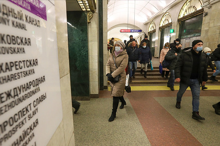 People wearing face masks as a  protective measure against the spread of coronavirus (COVID-19) walk around the subway amid coronavirus crisis. Russia has recorded at least 3633952 cases and 67220 deaths by the COVID-19 disease.
