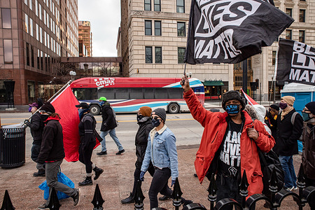 Demonstrators hold Black Lives Matter flags walking in front of the Ohio Statehouse.   Activist groups in Columbus came together to form the 'United Front Against the Far-Right and Capitalist System!' This demonstration began at Columbus City Hall, marched to the Columbus Statehouse and concluded with a march back to Columbus City Hall. Left wing activist groups organized this event, because they felt they needed to make their presence known to the Far-Right after supporters of the previous president, Donald J. Trump, breached the Capitol of the United States on Jan. 6, 2021.