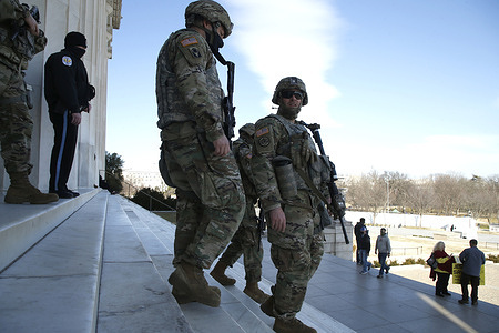 Florida National Guardsmen stand on guard around the Lincoln Memorial on the National Mall.  According to news sources neither the FBI nor Homeland Security made an announcement regarding lowering the present security level around the US Capitol and downtown Washington DC.