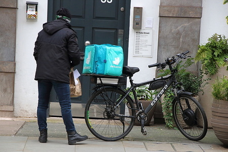 A Deliveroo Rider checks the order before delivering. With Covid-19 lockdown causing Restaurants, Cafes and Pubs all to close, many have turned to offering takeaway and delivery services. The big winners for this are the likes of the Deliveroo riders, seen almost everywhere you turn in London.