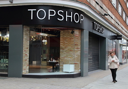 A woman walks past a closed up Topshop store near Marble Arch. Fashion chain Next has pulled out of talks to buy retail brands Topshop and Topman out of administration. It was thought to be the front-runner to buy the brands. Up to 13,000 jobs were put at risk when Arcadia, which owns Topshop amongst others, went bust last November.