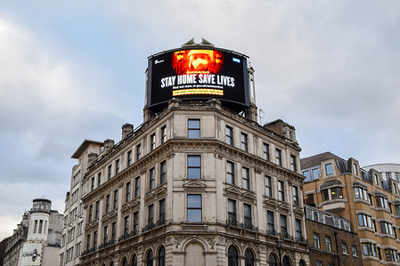The Stay Home, Save Lives billboard seen displayed in Central London. England remains under lockdown as the government battles to keep the coronavirus pandemic under control.