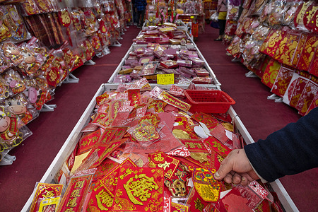 A man looks at a Chinese character 'good fortune' as he buys decorative ornaments during the preparation of the Chinese New Year celebration.  The former British colony of Hong Kong is preparing for the Lunar Chinese New Year 2021 of the Ox.