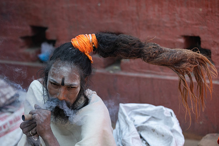 A Hindu holy man, or sadhu, smokes marijuana at the Pashupatinath Temple ahead of the Shivaratri festival in Kathmandu. Hindu Devotees from Nepal and India come to this temple to take part in the Shivaratri festival which is one of the biggest Hindu festivals dedicated to Lord Shiva and celebrated by devotees all over the world.