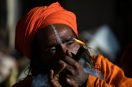 A Hindu holy man, or sadhu, smokes marijuana at the Pashupatinath Temple during the Mahshivaratri festival in Kathmandu. Hindu Devotees from Nepal and India come to this temple to take part in the Shivaratri festival which is one of the biggest Hindu festivals dedicated to Lord Shiva and celebrated by devotees all over the world.