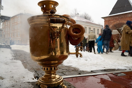 """Samovar seen at the Krutitsky Patriarch Compound during the Maslenitsa celebrations. Celebration of Maslenitsa in the Museum of Military History in the scenery of a real 17th century castle on the Krutitsky Patriarchal Compound in Moscow. """"Maslenitsa"""" is an Eastern Slavic religious and folk holiday which is celebrated the last week before the Great Lent."""