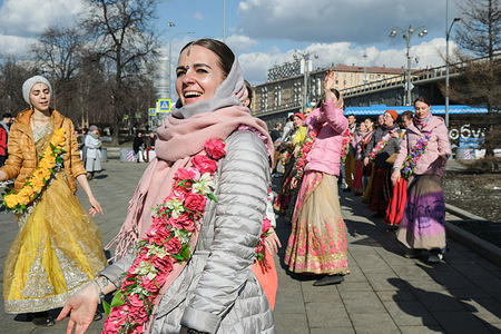 The Hare Krishnas stage a street performance for passers-by in Moscow.