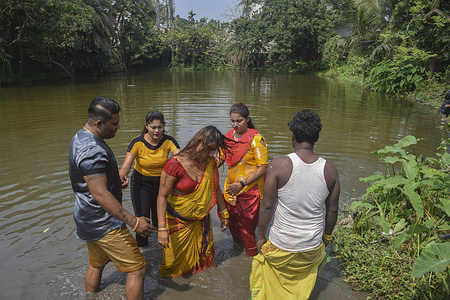 """A devotee goes into a trance right after the ritual bath. Tamil community of Bandel observe 'Vel Vel' festival to worship god """"Shitala maa"""".In this festival many devotees pierce their skin, tongue, or cheeks with vel skewers as they undertake a procession towards temple."""