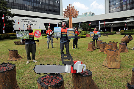 Environmental activists hold placards expressing their opinions during the demonstration. Greenpeace staged an action in front of the Ministry of Environment's building to stop violations of issuing forest release permits in Papua. The purpose of this action is to demand that the Government take corrective actions that forests and plantations that have not been damaged can be returned to the Indigenous Papuan people.