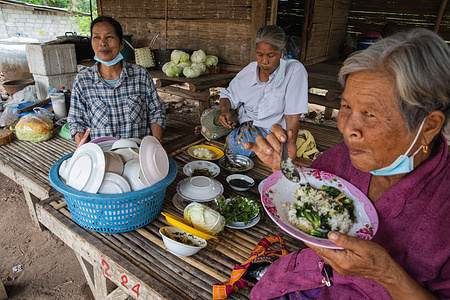 Elderly people in Borkeaw village seen eating vegetables and rice meals. Everyday life of the Thai people in the rural area of Thailand, 6 hours drive away from the capital Bangkok.
