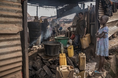 General view of an illegal alcohol production factory in a slum. Alcohol production is one of the major economy of many slums in capital city of Kampala, due to lack of education many residents of the slums are unemployed and they rely on alcohol to  pass their days.