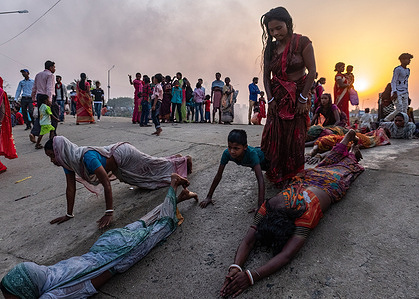 People perform 'Dondi' ritual (after taking a bath, they go to the temple in this way) during Gajan festival.Gajan is a Hindu festival celebrated mostly in the Rural part of West Bengal. The central theme of this festival is deriving satisfaction through non-sexual pain, devotion and sacrifice.