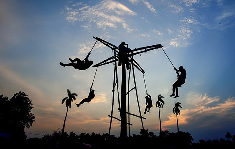 People Hook -swinging during the ritual.The Hook-swinging ritual and festival of Charak is where people hang by a rope from an erected pole and they revolve around the pole.