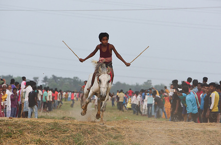 Children Jockeys ride horses without proper safety equipment's during a Horse Race in Rural Bengal.