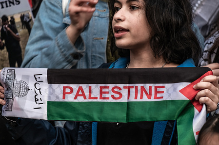 """A young protester in view showing a cloth band with the name of Palestine. Hundreds of people have gathered to commemorate the day of the Nakba """"catastrophe"""" or the beginning of the exodus. In the shadow of the recent genocide of the Israeli army in the Gaza Strip, the protesters have also demanded the boycott and seizure of military material to Israel."""