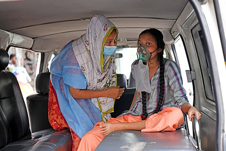 A Covid-19 patient is being taken to Dhaka Medical College Hospital with her family members for treatment in Dhaka.Bangladesh extends nationwide lockdown measures until May 05 and imposed a nighttime curfew to prevent further spread of COVID-19.