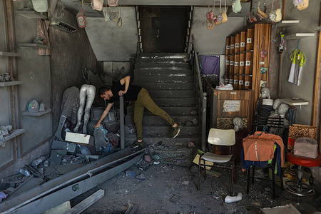 Palestinian inspects his shop after being damaged by Israeli air attack. Gazans tried to piece back their lives after a devastating 11-day conflict with Israel that killed more than 200 people and made thousands homeless in the impoverished Palestinian enclave.
