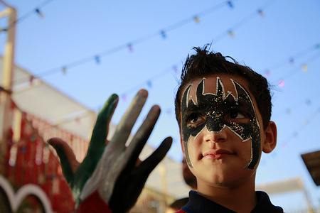 A Palestinian boy with a batman face paint near the site of Israeli airstrikes in Gaza. Gazans tried to piece back their lives, after a devastating 11-day conflict with Israel that killed more than 200 people and made thousands homeless in the impoverished Palestinian enclave.