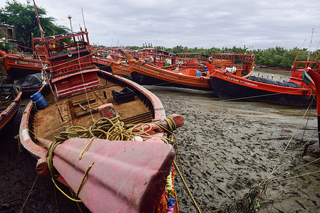 Fishing Trawlers are parked at a river canal adjacent to coastal lines as they are being warned not to venture into the sea due to a cyclone named YAAS,which is predicted to make landfall on 26th of May between West Bengal and Odisha coastal areas.