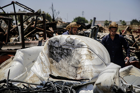 Palestinian workers salvage items at a damaged plastic pipes factory in Gaza's industrial area in the aftermath of the Israeli strikes. US top diplomat Antony Blinken vowed support to help rebuild the battered Gaza Strip and shore up a truce between Hamas and Israel, but insisted the territory's Islamist militant rulers would not benefit from any aid.