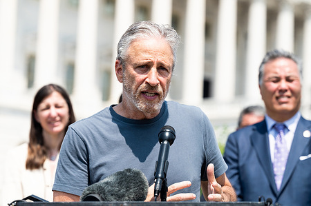 Jon Stewart speaking at a press conference to unveil legislation to help veterans exposed to toxic burn pits.