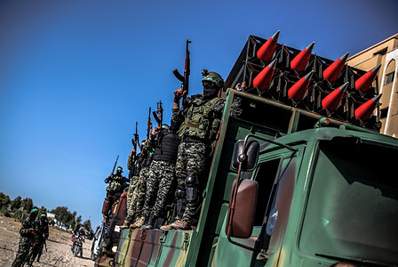 Members of the Izz al-Din al-Qassam Brigades, the military wing of Hamas display rockets during a military parade on the Streets in Khan Yunis, southern Gaza Strip.