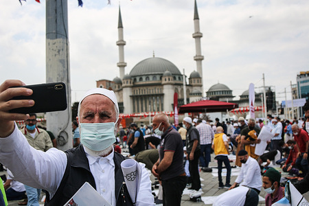 A Muslim man takes a selfie in front of the Taksim Mosque, which was inaugurated in Istanbul's central Taksim Square after the Friday prayers. Thousands of Muslims took part in a friday prayer as Turkish President Recep Tayyip Erdogan inaugurated the newly built Taksim Mosque in Istanbul's main square.
