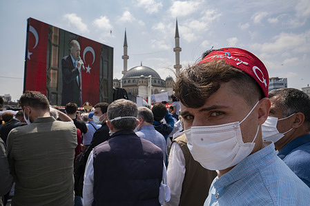 A young guy with the red cap looking at the camera during the opening ceremony of the Taksim Mosque. Turkish President Recep Tayyip Erdogan inaugurated the newly built Taksim Mosque in Istanbul's main square.