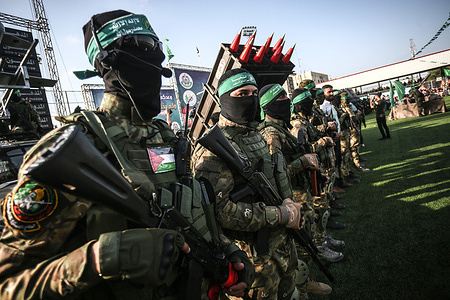 Masked gunmen from the Izz al-Din al-Qassam Brigades take part during an anti-Israel military parade in Rafah, in the southern Gaza Strip.