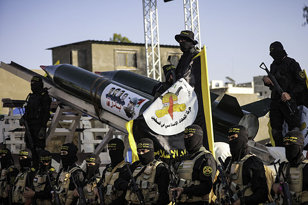 Fighters from the Saraya al-Quds Brigades, the armed wing of the Palestinian Islamic Jihad movement with Bader 3 rockets take part during the parade on the streets of Gaza City.