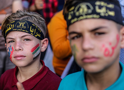 Young supporters of the Saraya al-Quds Brigades, the armed wing of the Palestinian Islamic Jihad movement, attend the parade on the streets of Gaza City. The parade took place more than a week after a ceasefire brought an end to 11 days of hostilities between Israel and Hamas.