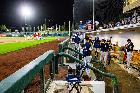 The Reno Aces celebrate a win while the Tacoma Rainiers pack up, during the Reno Aces vs the Tacoma Rainiers game at Greater Nevada Field.(Final score: Reno Aces 8-7 the Tacoma Rainiers).