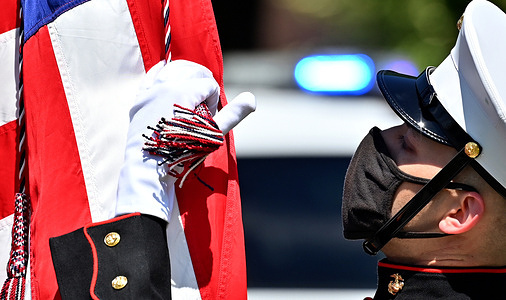 The Marine honor guard member holds the American Flag during a Memorial Day parade. In remembrance of those who died in military service, a memorial day parade marched from Kingston Pa, to the Forty Fort Cemetery in Forty Fort, PA. The  previous year's event was cancelled due to Covid.