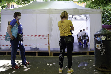 Women wait to be vaccinated with the Johnson & Johnson COVID-19 vaccine outside a gazebo in Rome.From today 1 June, vaccinations against Coronavirus COVID 19 in pharmacies have begun in Italy.