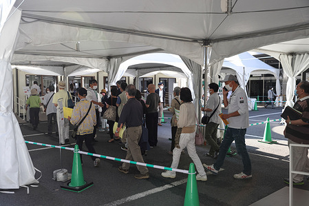 Visitors walk to the waiting tent at the vaccination centre. Opened on May 24, 2021, the mass vaccination center in Otemachi is run by the Self-Defense forces and 10,000 people can be vaccinated in one day.