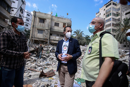 Robert Mardini (Navy blue Jacket),  Director General of the International Committee of the Red Cross (ICRC) along with his team speak to Al Wehda resident whose home was destroyed in the Israel airstrike attack.Robert Mardini, Director General of the International Committee of the Red Cross (ICRC) will undertake several field trips to witness firsthand situation in Gaza, the West Bank, and the South of Israel after 11 days of hostilities between Israel and Gaza rulers Hamas. The Director also intends to renew the commitment of the ICRC to people affected by the conflict.