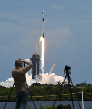 A SpaceX Falcon 9 rocket with a Dragon 2 spacecraft carrying supplies to the International Space Station lifts off from pad 39A at the Kennedy Space Center. This is the 22nd resupply mission for NASA by SpaceX.