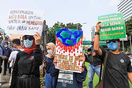 Activists holding placards expressing their opinion as they take part in a rally ahead of World Environment Day.World Environment Day is celebrated annually on 05 June and aims to encourage awareness and environmental protection.