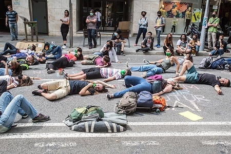 Protesters seen laying on the ground during the demonstration. The environmental activists of Extinction Rebellion of Barcelona, have demonstrated at the Ministry of Environment and Sustainable Development of Catalonia building to demand from the Minister of Climate Action, Food and Rural Agenda, Teresa Jorda, the commitment to create a Citizen Assembly for Climate in the Catalan areas. In the end, the agreement has been accepted by the Minister.